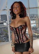 Chocolate Nody fucking herself in a corset