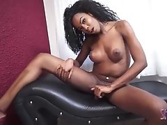 Patricia Campbell strokes her massive black tgirl dick until hot cum explodes