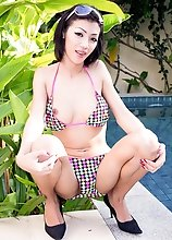 Busty Ladyboy Won in Bikini Posing Near the Pool and Toying