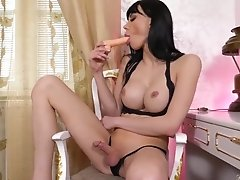 Watch Bailee Paris fuck and suck her favorite toy after playing with her sexy feet