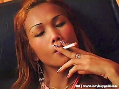 Sexy Ladyboy Em smoothly smokes her cigarette in tight capri pants