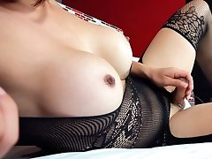 Busty Japanese American babe in Bodystocking