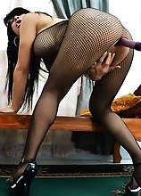 Lucious Asian Shemale in bodystocking with a long dildo in her asshole