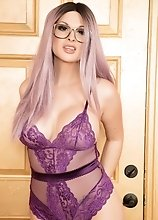 Bailey Jay looks gorgeous in purple and gold especially with her hard pulsating cock out for all to see
