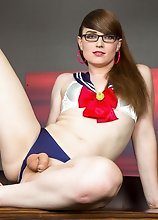 Slim tgirl Natalie Mars in a sexy sailor girl outfit fucks herself with her big dildo and jacks her rock hard cock!