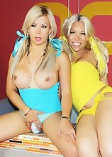 Two Blonde shemales lick their tits and suck their cocks