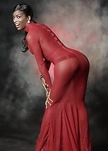Black Natassia posing in red dress