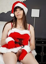 Looking all sexy dressed in her Christmas outfit, Tallia Skye strokes her rock hard cock until she cums!